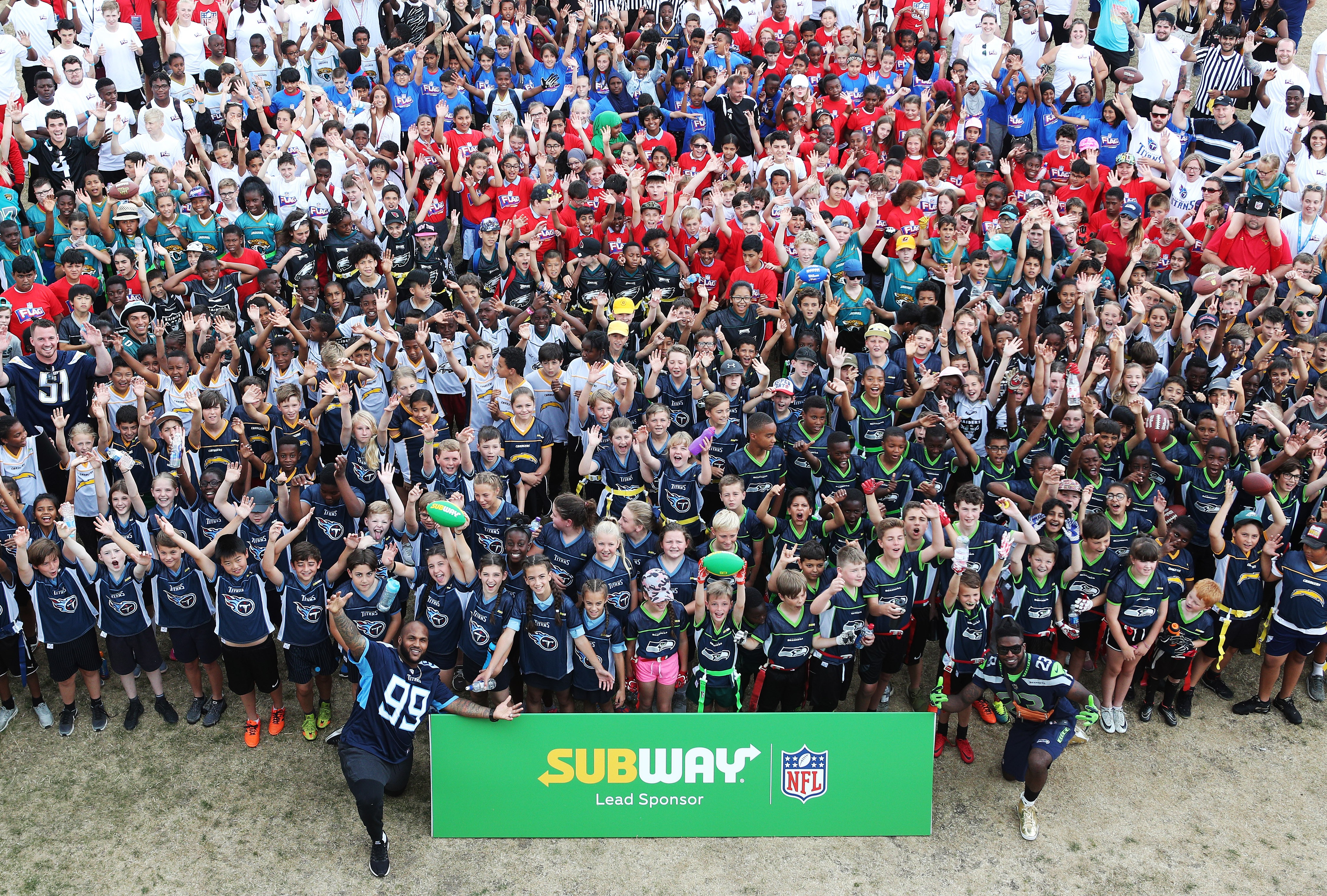 FREE FOR EDITORIAL USE - NFL London Games players Jurrell Casey (TENNESSEE TITANS) and Neiko Thorpe (SEATTLE SEAHAWKS) pictured at the NFL Flag Summer Bowl finale, presented by Subway, celebrate the 2017-2018 tournaments, played by over 10,000 kids across the UK. Schools can register interest online at http://bit.ly/NFLFlagSubway